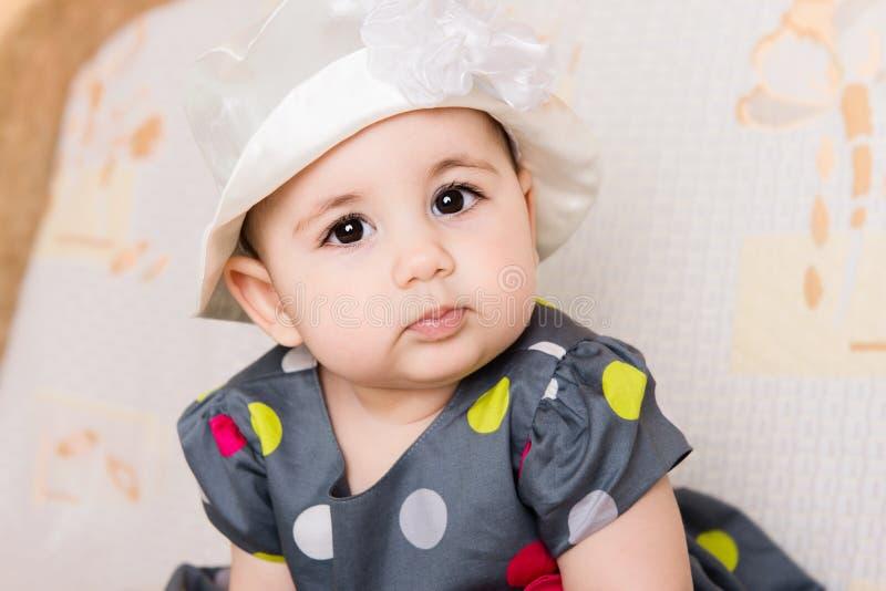 Bebê bonito no vestido pontilhado fotografia de stock royalty free