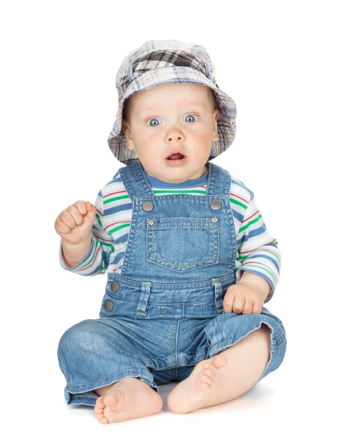 Bebê bonito pequeno nas calças de brim fotos de stock