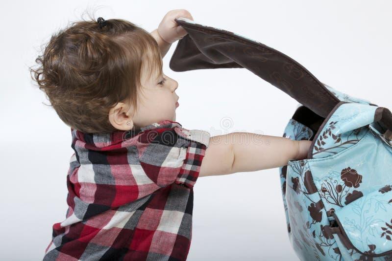 Bebê com bolsa imagem de stock