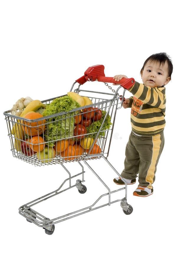 Bebê com carro de compra fotografia de stock
