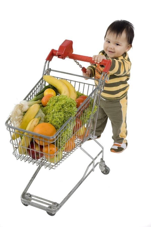 Bebê com carro de compra imagem de stock