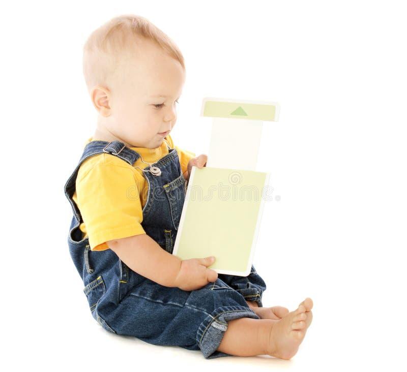 Bebê com cartão instantâneo fotografia de stock