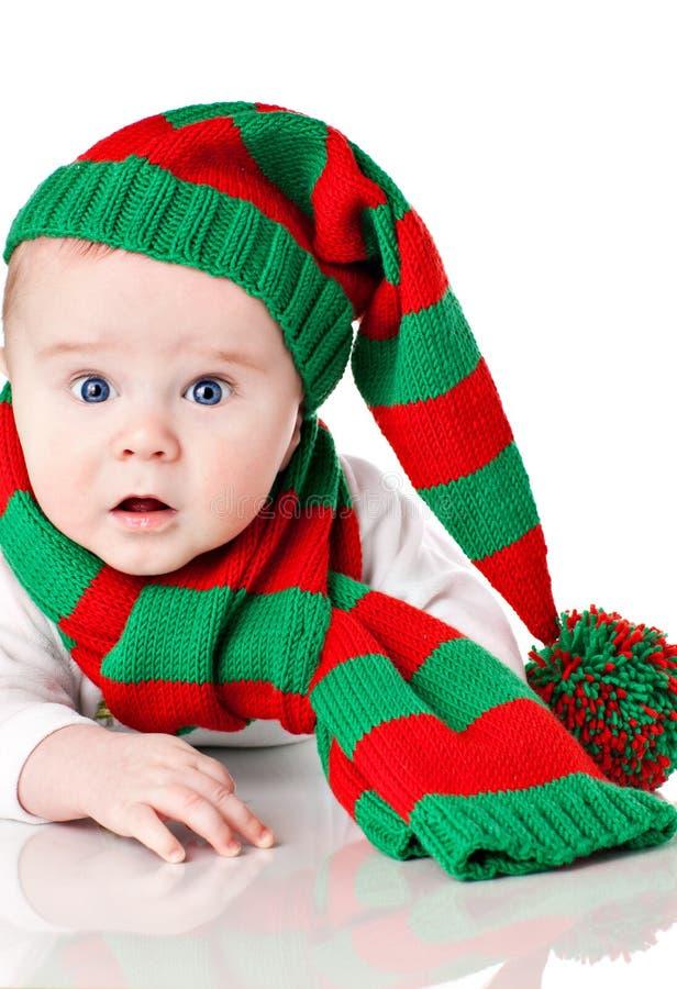 Bebê com chapéu e lenço do Natal fotografia de stock