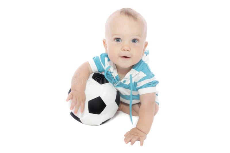 Bebê com esfera de futebol imagens de stock
