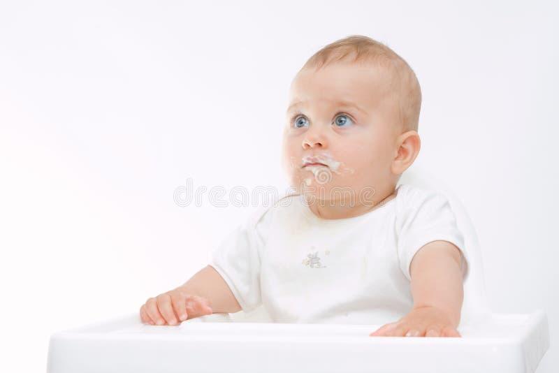 Bebê com face suja fotografia de stock