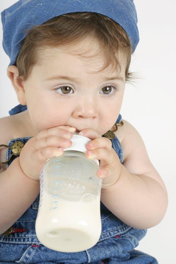Bebê com frasco fotografia de stock royalty free