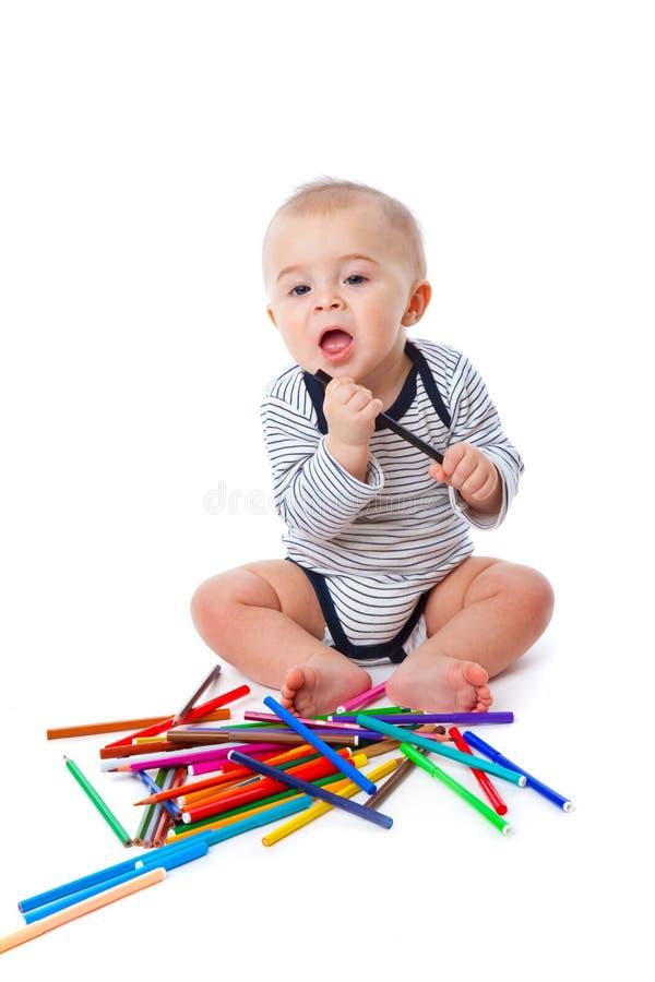 Download Bebê com lápis imagem de stock. Imagem de cheerful, caucasiano - 12808503