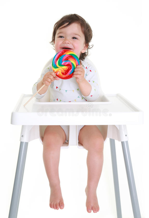 Bebê com lollypop fotos de stock royalty free