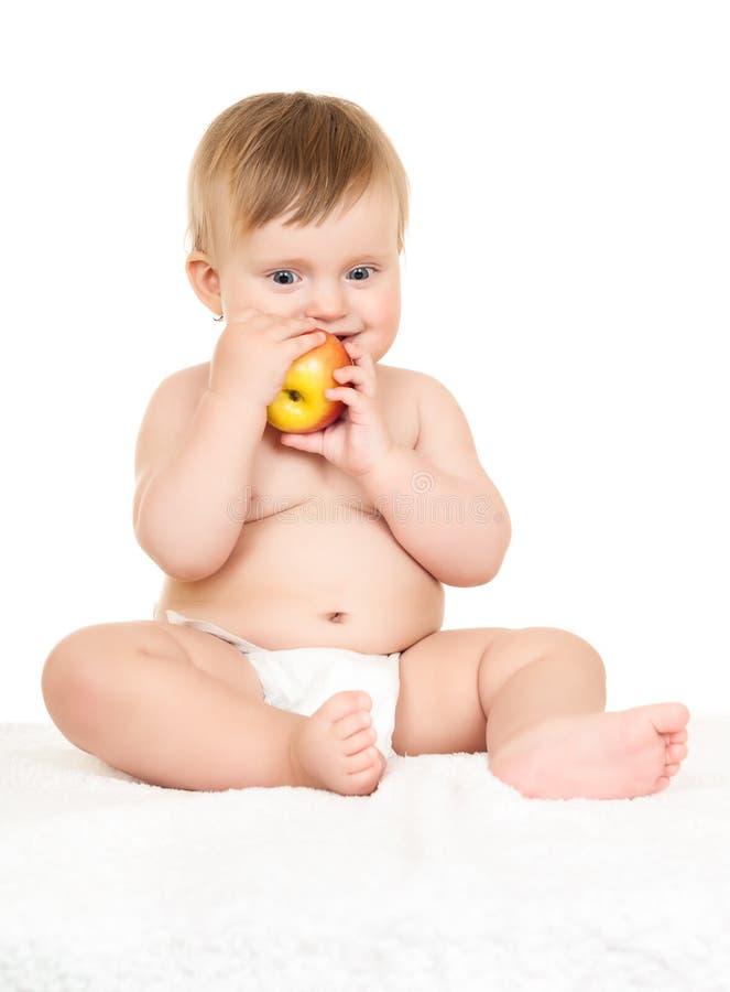 Bebê com maçã foto de stock royalty free