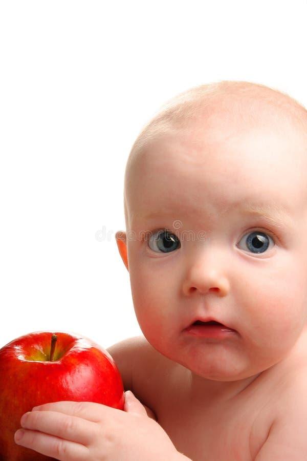 Bebê com maçã fotografia de stock royalty free