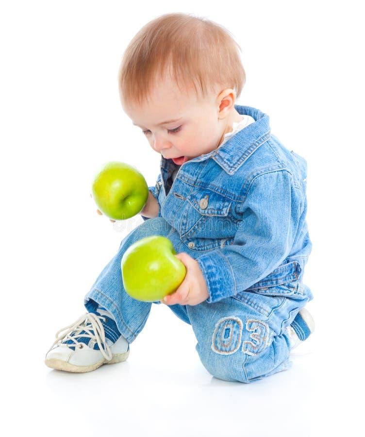Bebê com maçã verde imagens de stock royalty free