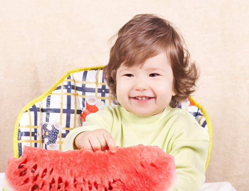 Bebê com melancia foto de stock royalty free