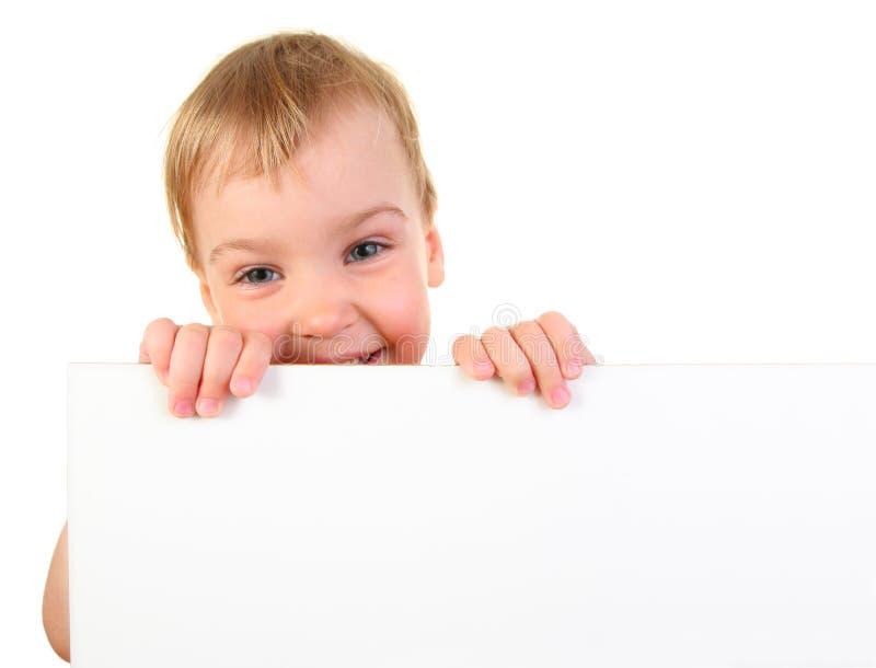 Bebê com o cartão para o texto imagens de stock royalty free