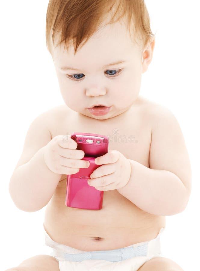 Bebê com telefone de pilha imagem de stock royalty free