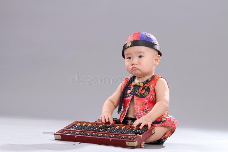 Bebê de assento fotos de stock