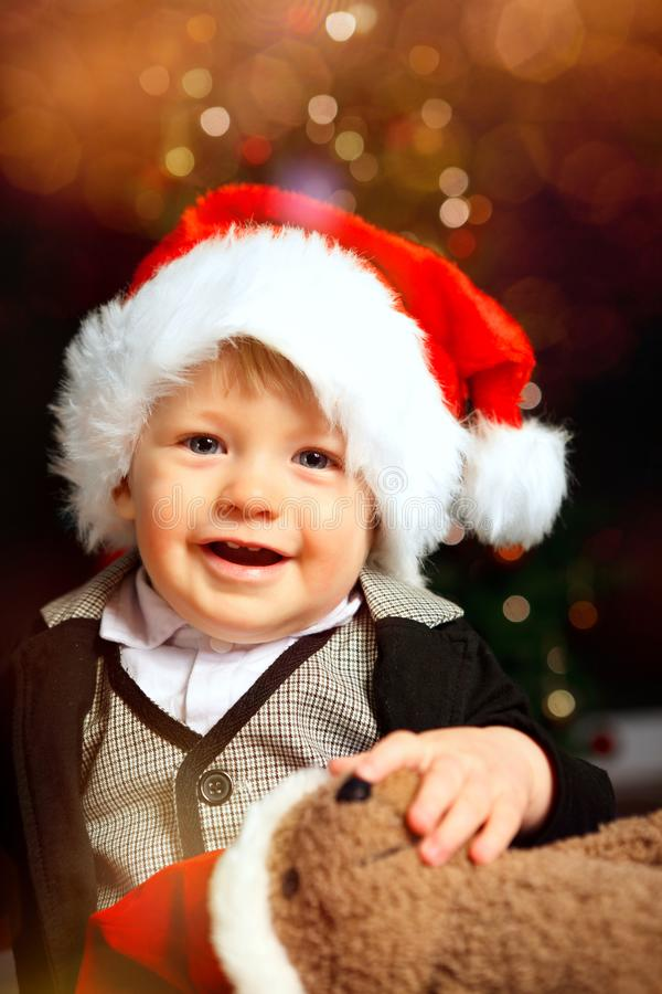 Bebê de Santa com sorriso do chapéu de Santa foto de stock royalty free