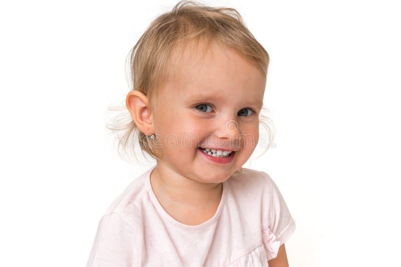 Bebê de sorriso bonito isolado no fundo branco imagem de stock