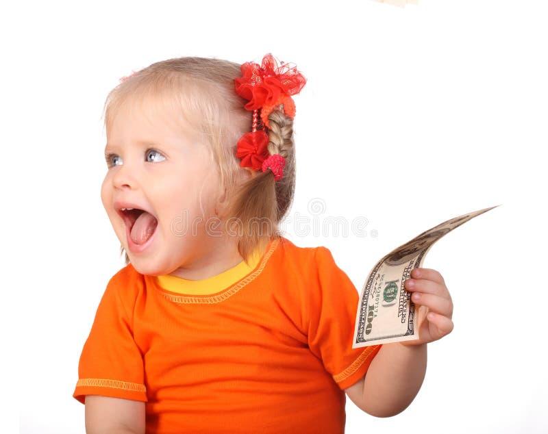 Bebê de sorriso no dólar de tomada alaranjado. fotografia de stock