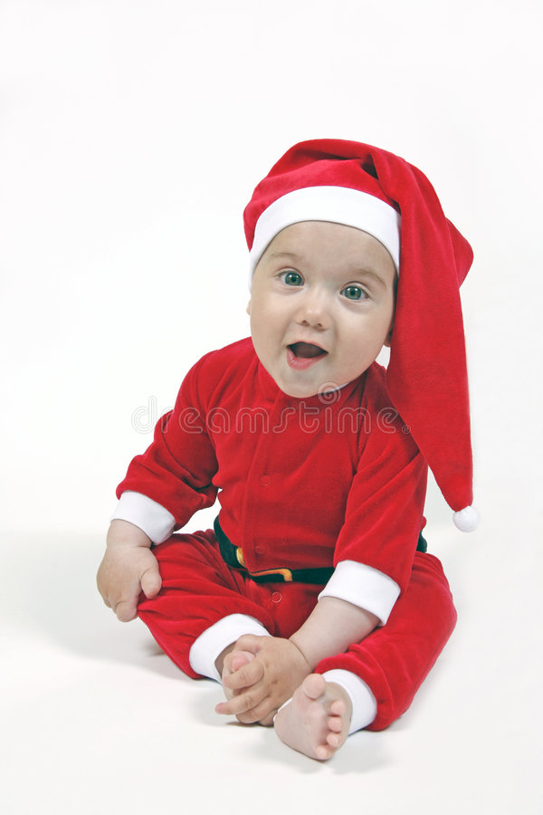 Bebê de sorriso no terno do Natal fotos de stock