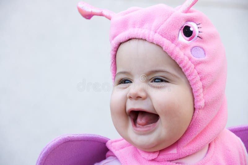 Bebê de sorriso no traje fotografia de stock royalty free