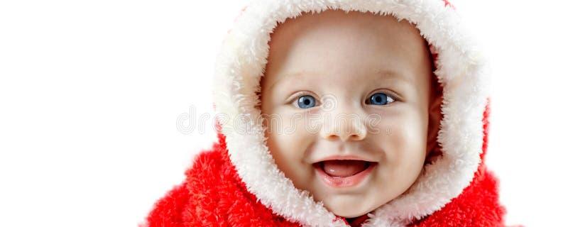 Bebê de sorriso no vestido de Santa Claus imagens de stock royalty free