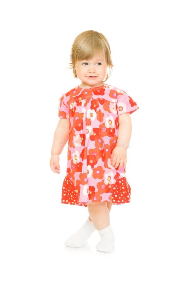 Bebê de sorriso pequeno no vestido vermelho isolado fotografia de stock royalty free