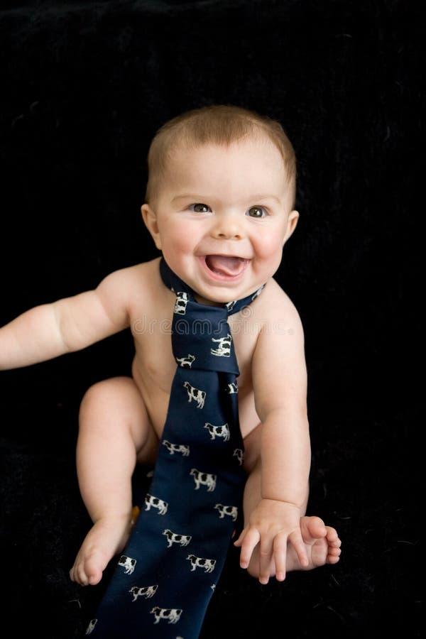 Bebê despido no laço imagens de stock