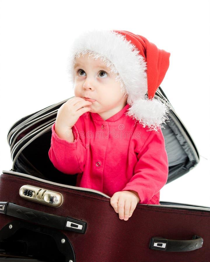Bebê do Natal na mala de viagem foto de stock royalty free