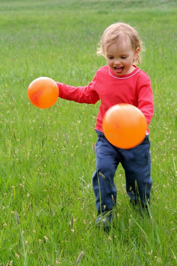 Bebê e balões imagem de stock royalty free