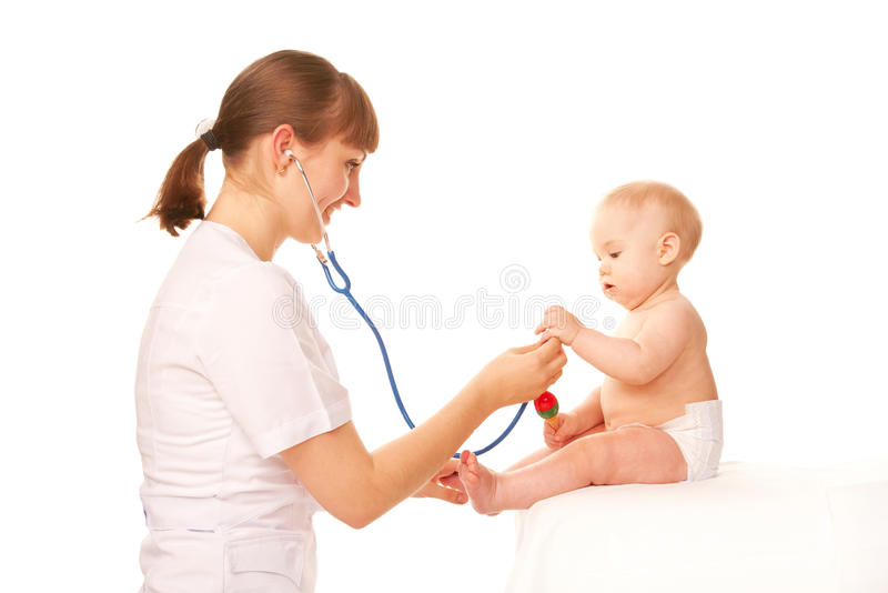 Bebê e doutor. foto de stock