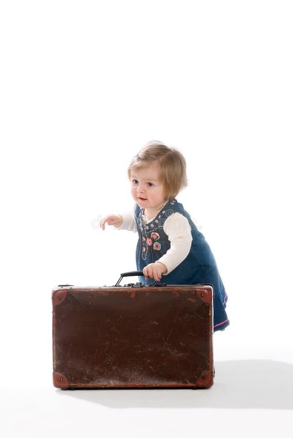 Bebê e mala de viagem fotografia de stock royalty free