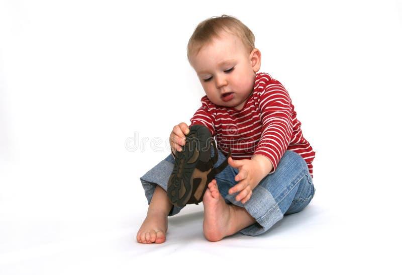 Bebê e sapatas imagem de stock