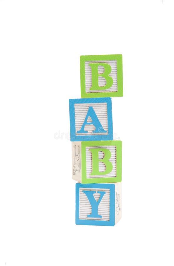 Bebê escrito em blocos dos childs com trajeto de grampeamento imagem de stock royalty free