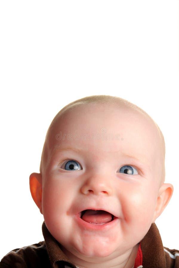 Bebê feliz bonito que olha acima com quarto para o texto fotografia de stock royalty free