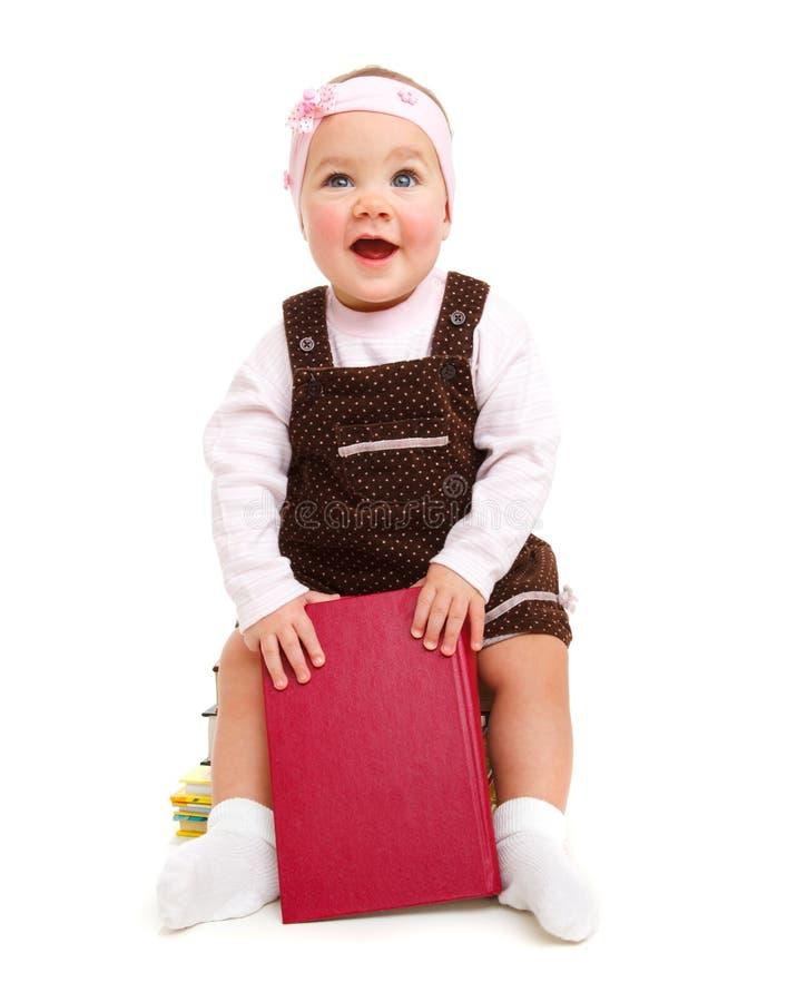 Download Bebê Feliz Que Senta-se Em Livros Imagem de Stock - Imagem de feliz, curioso: 12800055