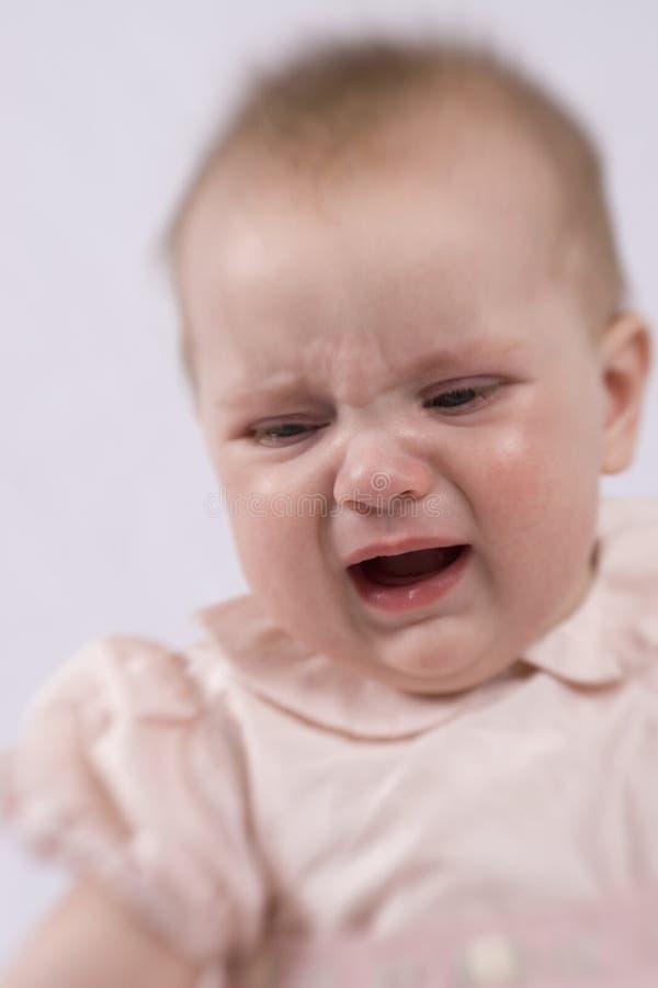 Bebê irritado fotos de stock