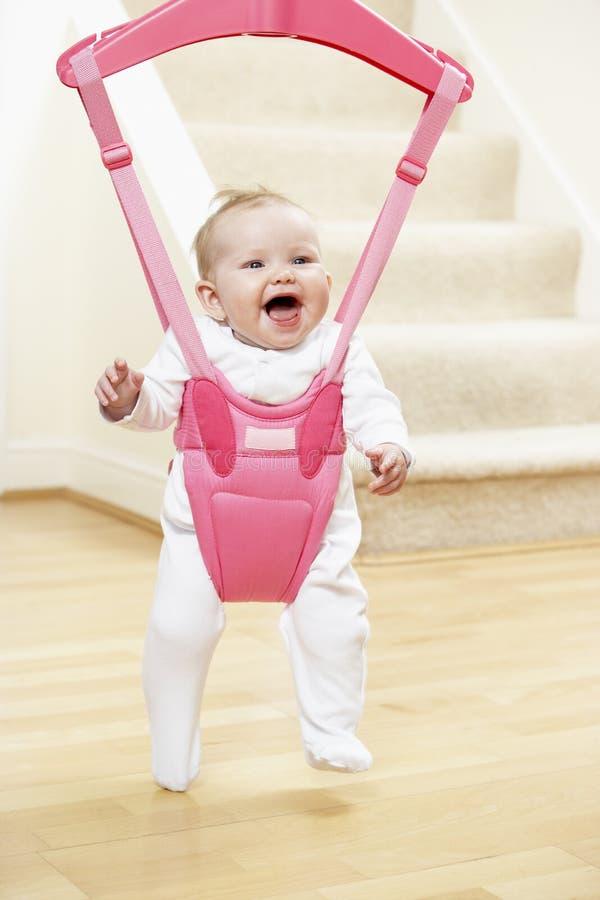 Bebê no Bouncer fotografia de stock