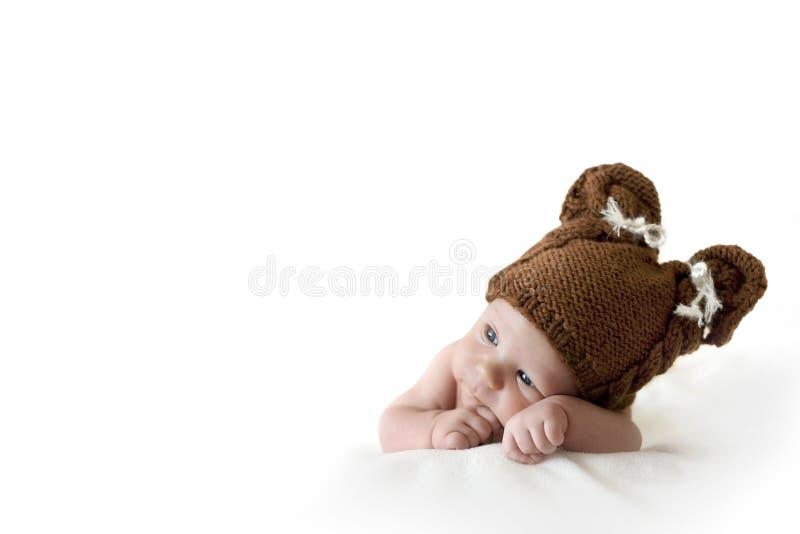 Bebê no chapéu do urso fotos de stock
