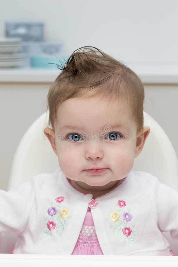 Bebê no highchair imagem de stock royalty free
