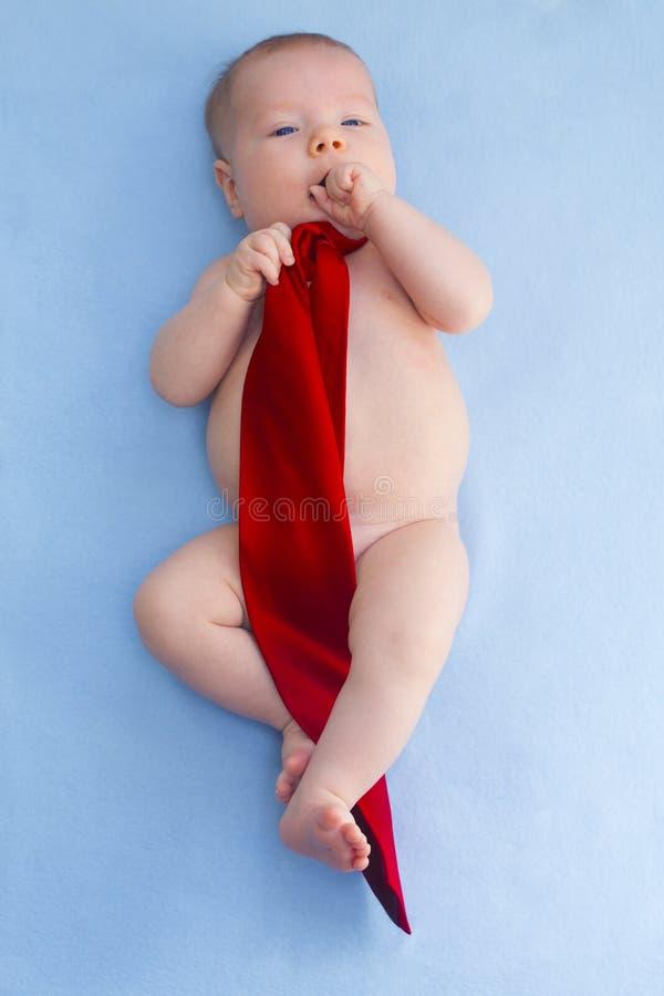 Bebê no laço imagem de stock