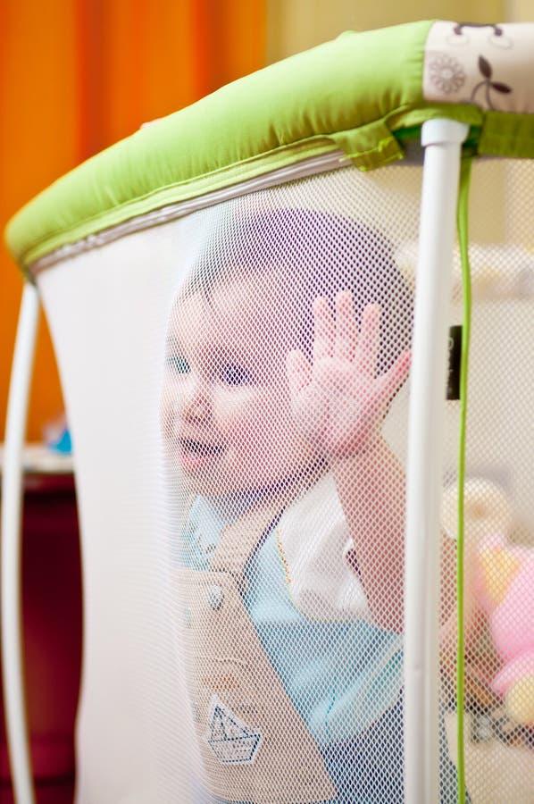 Bebê no playpen imagem de stock royalty free