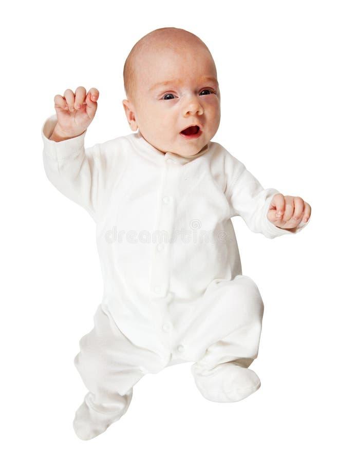 Bebê no romper branco sobre o branco fotografia de stock royalty free
