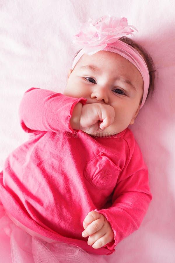 Bebê no vestido cor-de-rosa fotografia de stock royalty free
