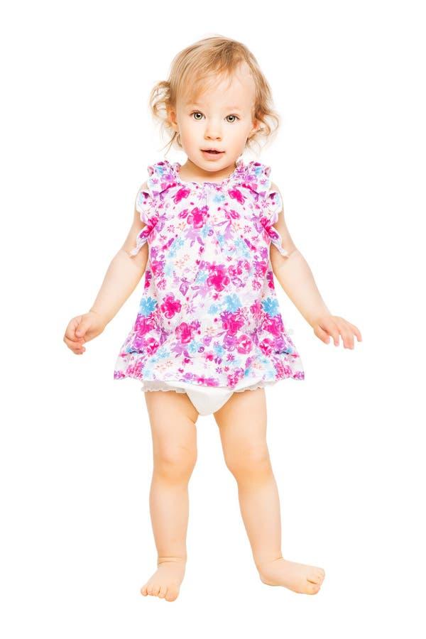 Bebê no vestido, criança que está em branca, criança de um ano da criança imagens de stock