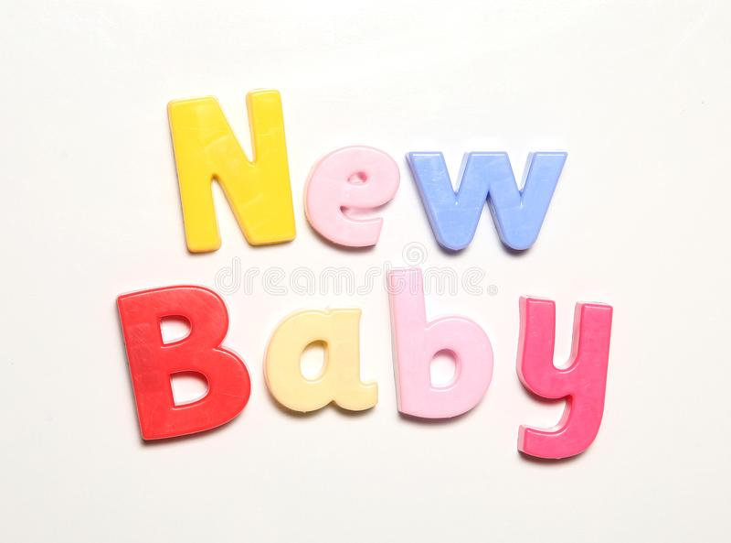 Bebê novo soletrado nos ímãs fotos de stock royalty free