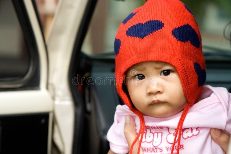 Bebê pensativo que olha fixamente em você fotografia de stock royalty free