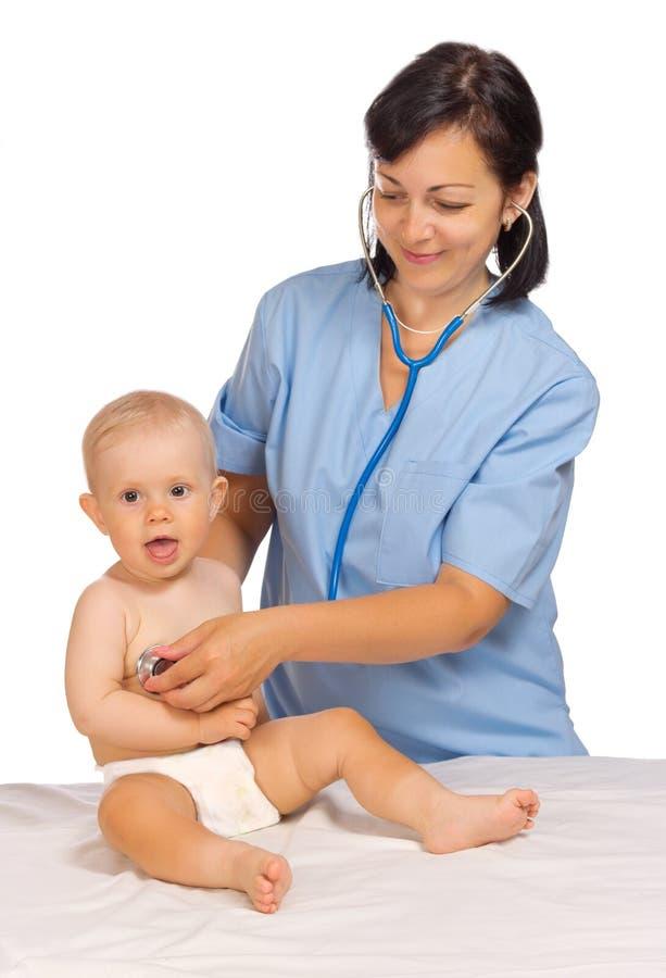 Bebê pequeno com doutor fotos de stock