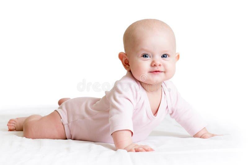 Bebê que encontra-se em sua barriga imagens de stock royalty free