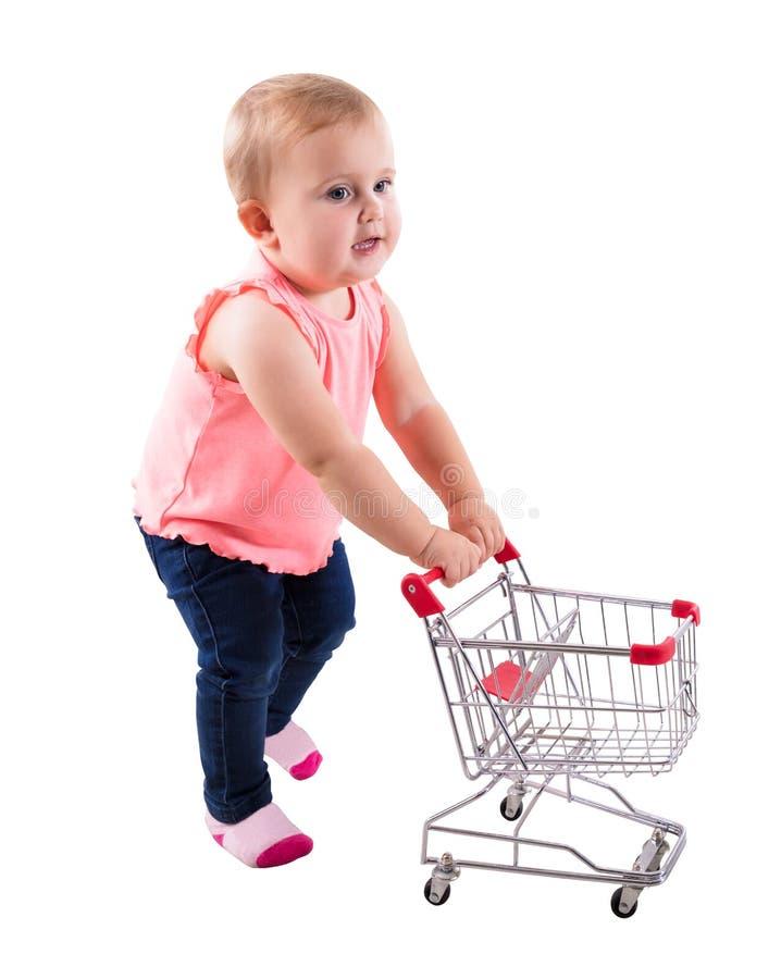 Bebê que guarda o carrinho de compras pequeno foto de stock royalty free