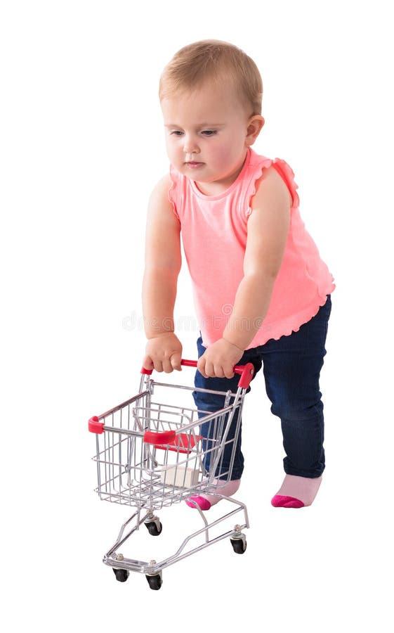 Bebê que guarda o carrinho de compras pequeno fotografia de stock